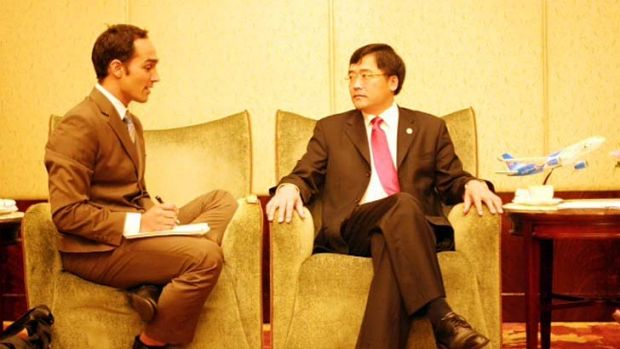 Contacts: Garnaut with Tan Wan'geng, president of China Southern Airlines.