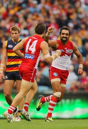 Adam Goodes  and Craig Bird celebrate another goal.