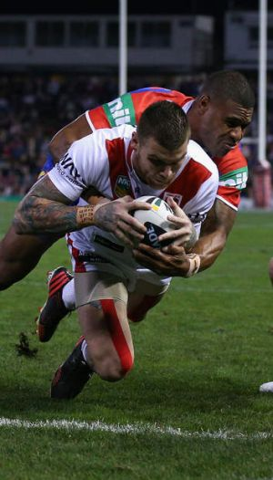 Game-breaker: Josh Dugan crashes over during his standout performance.