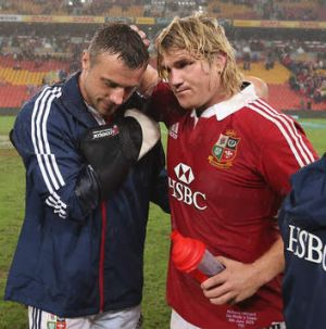 Another casualty: Tommy Bowe is consoled by Richard Hibbard after breaking his hand against the Reds. The injury rules ...