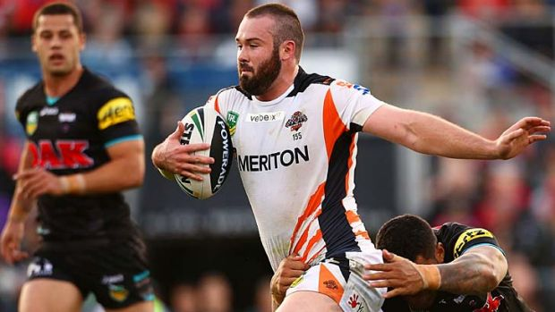 Tearaway Tiger: Aaron Woods goes for a run during the Wests Tigers' upset victory over the Panthers in Penrith.