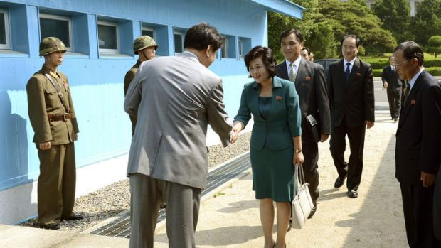 Kim Song Hye, center, the head of North Korea's delegation, shakes hands with an unidentified South Korean officer ...