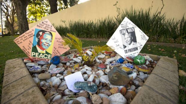 Messages for Nelson Mandela are pictured outside of his Johannesburg home.