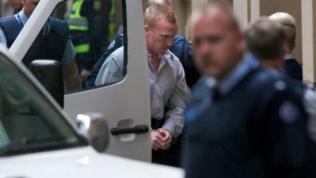 A handcuffed Adrian Ernest Bayley arrives at court on Tuesday morning.