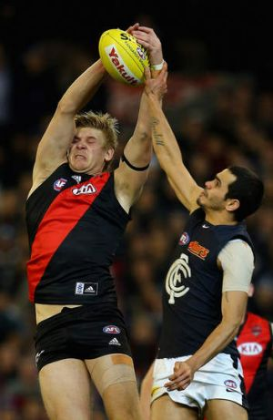 Michael Hurley of the Bombers marks in front of Jeff Garlett of the Blues.