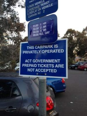 Sign informing drivers of the changes in the carpark's rules.