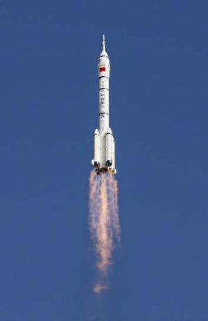 15-day mission: The Long March 2-F rocket loaded with Shenzhou-10 .