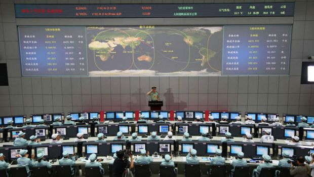 We have lift off: Chinese chief mission commander Zhang Youxia salutes after announcing the successful launch of the ...