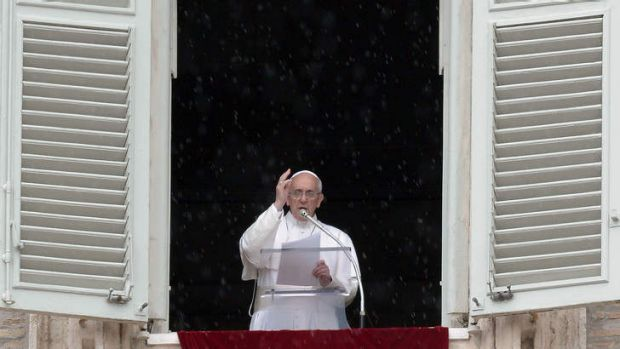 Pope Francis blesses faithfuls gathered in St.Peter's Square at the Vatican following his Sunday Angelus prayer on June ...