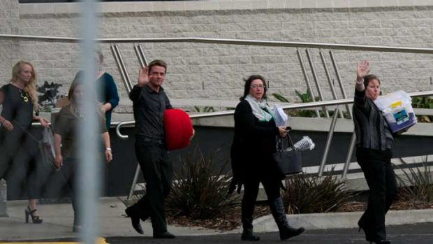 Sacked Target staff leave the company's Geelong headquarters.