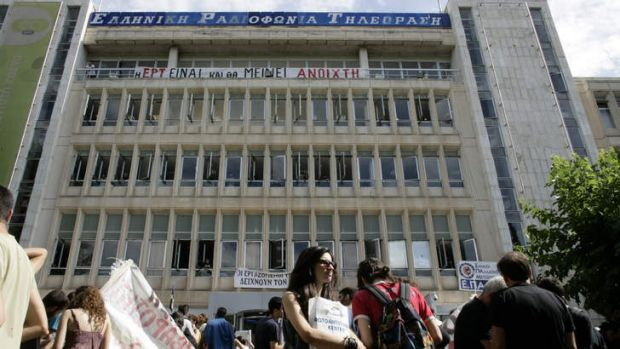 People arrive to support staff occupying the headquarters of the Greek public broadcaster ERT following the announcement ...