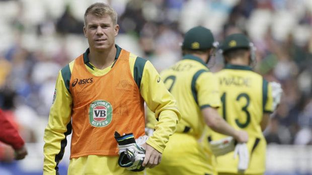 Sidelined ... David Warner walks off the field after a drinks break in his role a non-playing reserve on Wednesday.