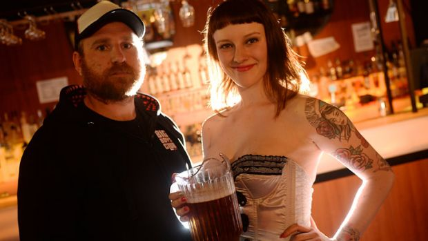 Coming to Chapel Street ... Red Bennies' Jeff Yates, with waitress Tayla, copyrighted the term Schnitz 'n Tits.