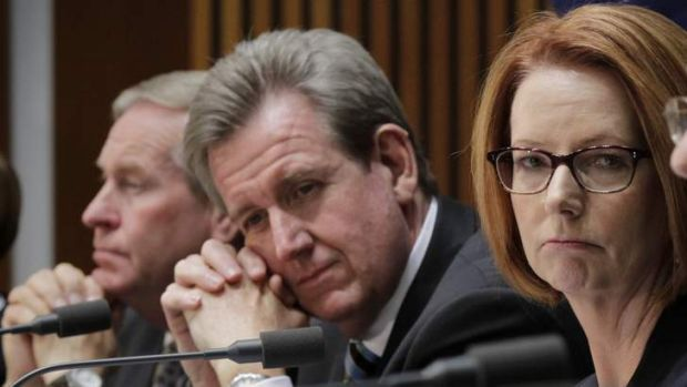 NSW Premier Barry O'Farrell (centre) has raised questions about the increased Gonski offer made by Prime Minister Julia ...