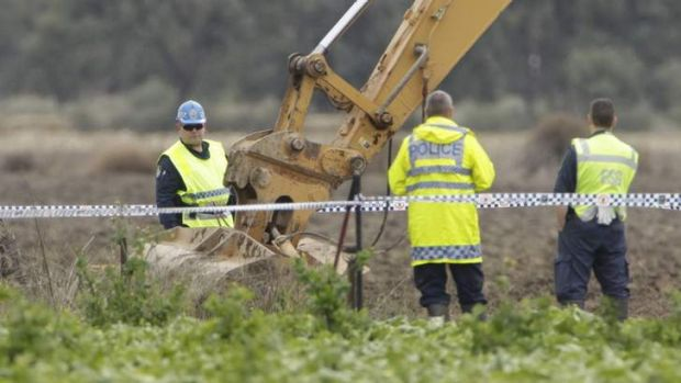 Police excavate a dam as they continue the search on a property near Hay for the remains of Donald Mackay.