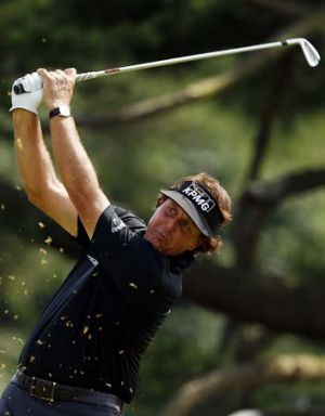 Phil Mickelson of the United States hits his tee shot on the ninth hole during Round One of the 113th US Open in ...