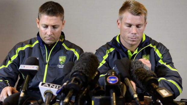 No drink problem: David Warner fronts the media with captain Michael Clarke.