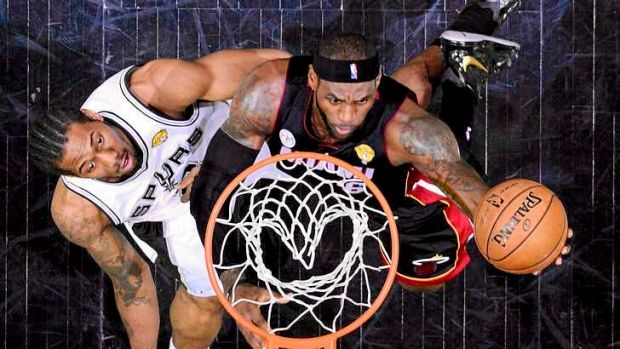 LeBron James scored 33 points as the Miami Heat levelled the NBA final series against the San Antonio Spurs.