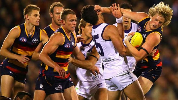 In your face: Ryan Crowley gets up close and personal with Adelaide's Rory Sloane and his teammates during last year's ...