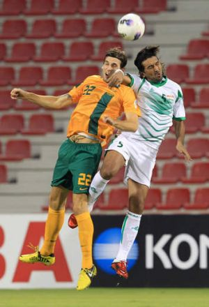 Headed out: Matthew Spiranovic with Iraqi player Nashat Akram, who has 'retired'.