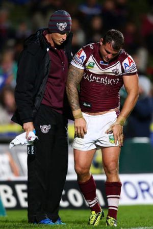 Anthony Watmough is assisted from the field.