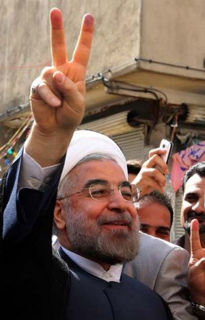Popular: an optimistic Hassan Rohani outside a polling station.