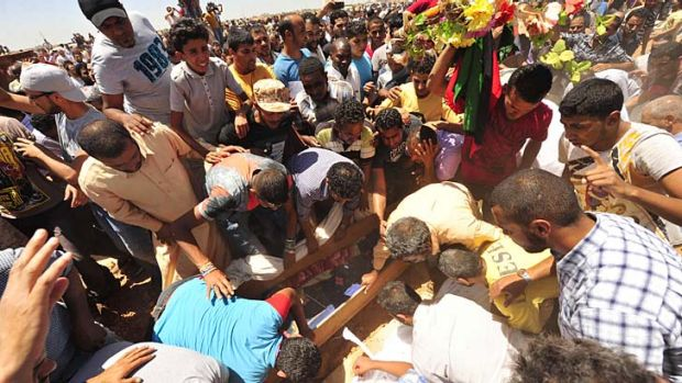 Crowds mourn during the funerals of protesters killed in Saturday's clashes.
