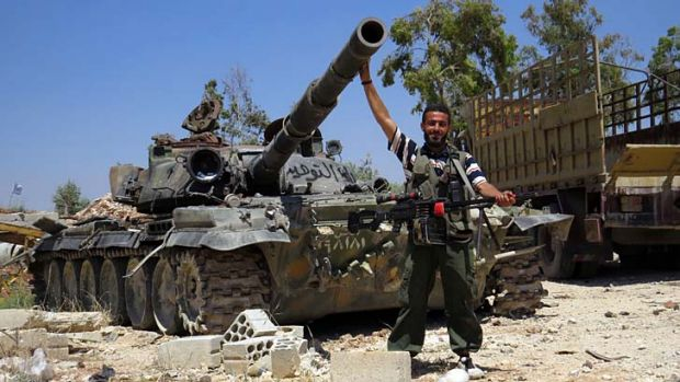 A rebel fighter with a tank reportedly confiscated from an army barracks. The US has sharply toughened its line on ...