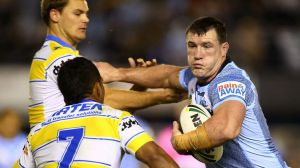 Determination: Paul Gallen of the Sharks runs the ball up against the Eels on Saturday night.
