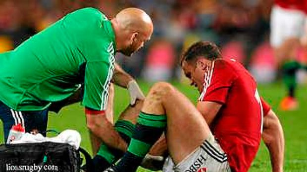 Out: Jamie Roberts receives medical attention against the Waratahs.