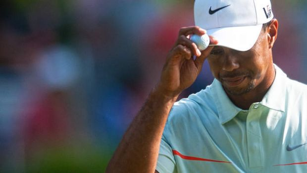 Let-down: Tiger Woods acknowledges the crowd during his disappointing third round of the US Open at Merion Golf Club.