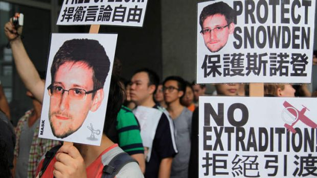 Freedom: Hong Kong residents show their support for Edward Snowden during a rally outside the government's offices.