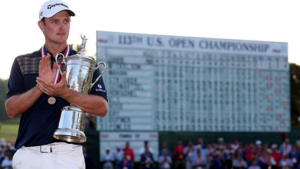 Dramatic win: Justin Rose celebrates with the US Open trophy.
