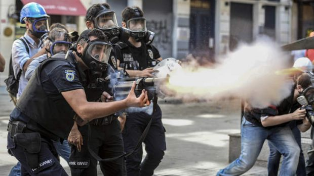 Crackdown: Police fire tear-gas as riot police spray water cannon at demonstrators who remained defiant after ...