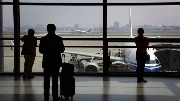 Ready for takeoff: Passengers watch a China Southern Airlines plane take off at Shanghai's Hongqiao International ...