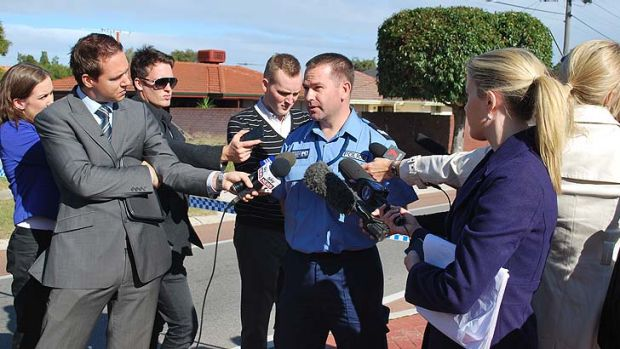 Senior Constable Pete Price talks to media near the scene of the accident that claimed the life of an 11-year-old boy ...