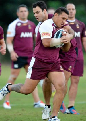 Josh Papalii passes the ball during a Queensland Maroons State of Origin training session at Palmer Resort Coolum on May ...