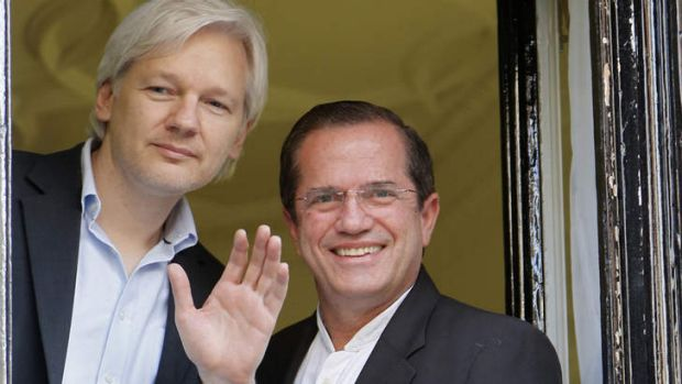 Window on the world: WikiLeaks founder Julian Assange waves to supporters with Ecuador's Foreign Affairs Minister ...