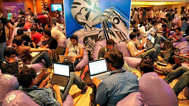 Participants use their laptop computers during the fifth edition of Open Hack India, a 24-hour non-stop hacking event ...
