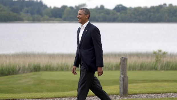 US President Barack Obama walks toward a welcome area during arrivals for the G-8 summit at the Lough Erne Golf Resort ...