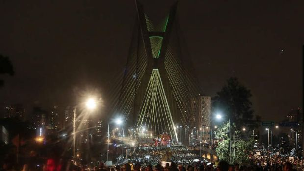 Tens of thousands of people took to the streets of major Brazilian cities protesting the billions of dollars spent on ...