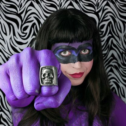Who do you think this is? Hit Girl from Kick-Ass? Wrong. It's The Phantom.... (Billy Zane is weeping into his onesie ...