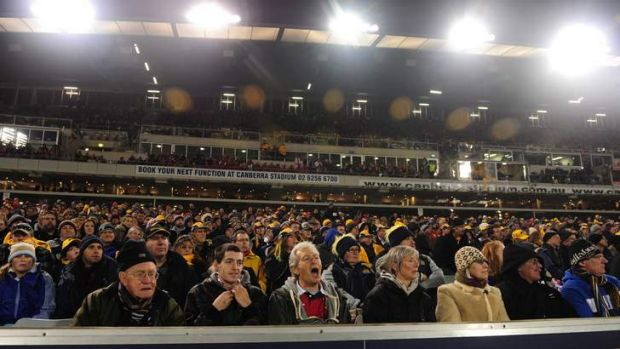Supporters watch the Brumbies take on the British and Irish Lions at Canberra Stadium.