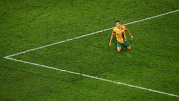 On his knees: Tim Cahill misses a good chance.