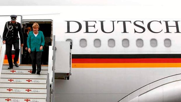 German Chancellor Angela Merkel disembarks from at Belfast International airport in Belfast, Northern Ireland, to attend ...