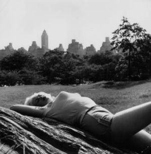 Screen goddess ...  Film actress Jayne Mansfield (Vera Jane Palmer, 1932 - 1967) relaxing in Central Park, New York.