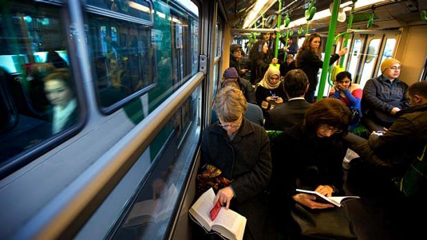 Commuters on a packed No. 55 tram.