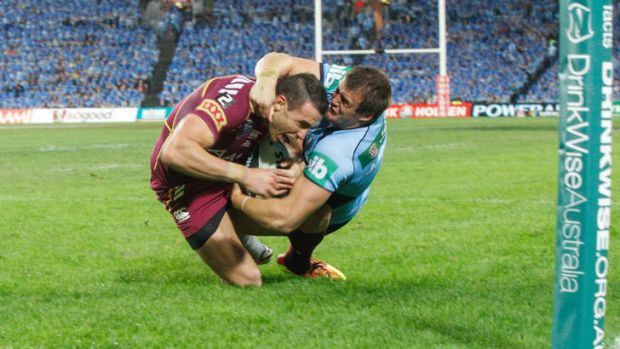 Ready for another onslaught: Josh Morris brings down Darius Boyd in game one.