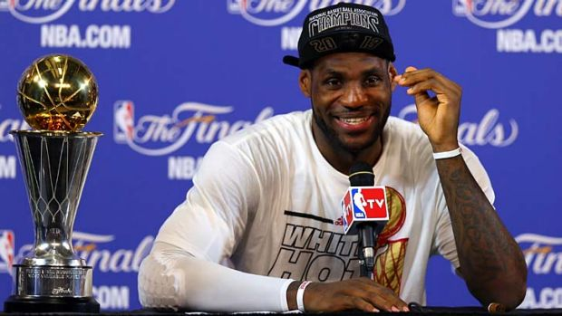 Star man: LeBron James speaks to the media after the Heat's victory.