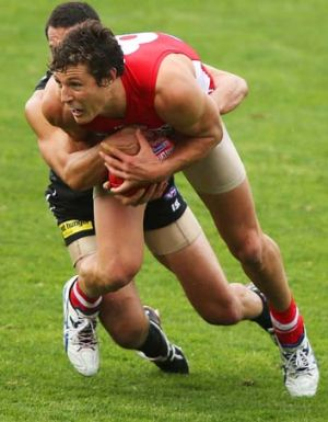 Kurt Tippett of the Swans wins the ball, but he was unable to help the Swans to victory in the match.